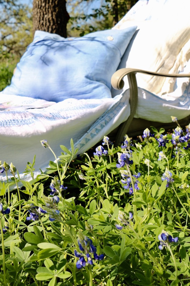 Add cushions to a chaise lounge in the backyard flowers to encourage yourself to relax