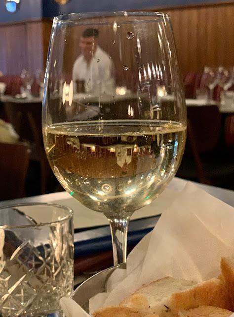 video of 40 Dean Street through wine glass
