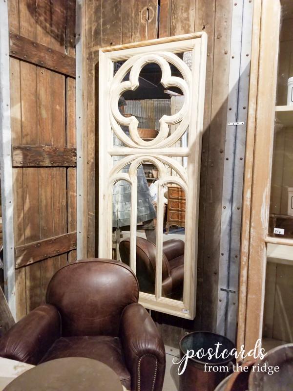 salvaged quatrefoil window made into a mirror