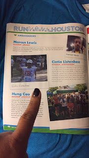 runner points at photo in the marathon book