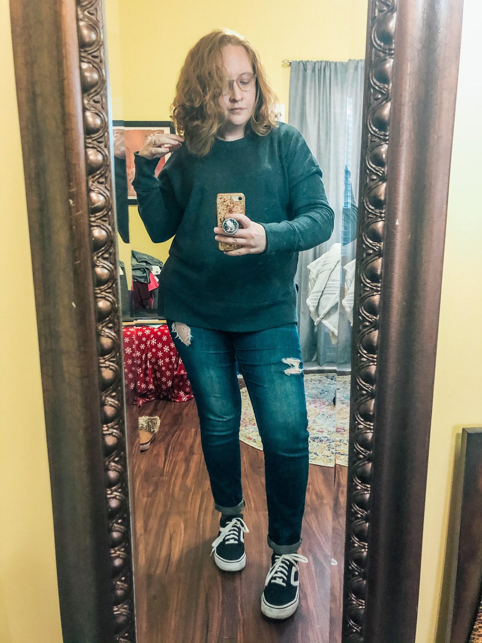 gray-sweatshirt-distressed-jeans-sneakers