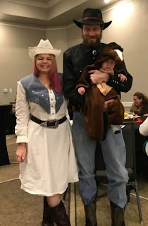 The Nietfeld Family. Maureen dressed up as a rodeo gal, David the cowboy, and Logan their baby horse