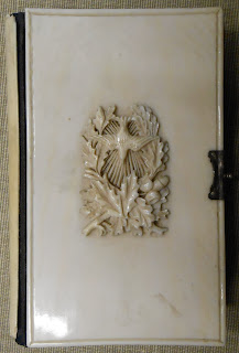 An ivory cover with a bird decoration.