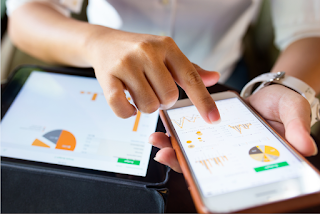 Person viewing marketing analytics on mobile devices