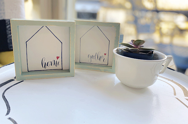 home and gather signs with a succulent in a cup