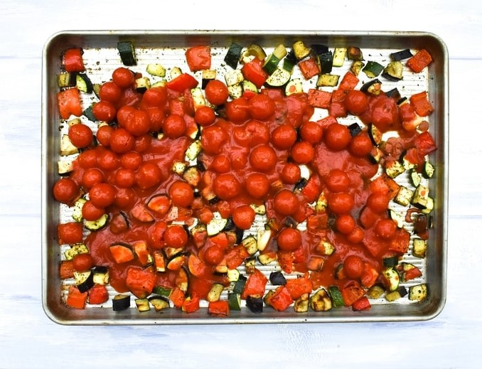 How to make ratatouille pasta - step - 3 - cherry tomatoes added to the cooked veg