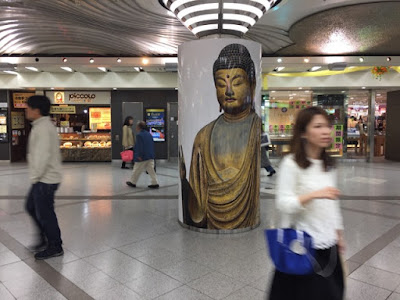 Buddha at Osaka City Station, Japan photo by Sydney Solis