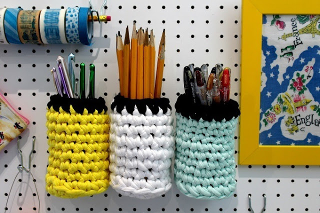 Crochet storage pots for your pegboard.