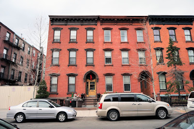 Two, three story red brick row houses
