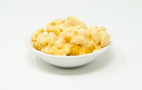 Creamy macaroni cheese in a white bowl