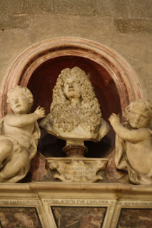 Detail from the funeral monument to Redi in Arezzo's duomo