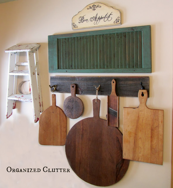 Photo of a cutting board wall display with barn wood wall hooks