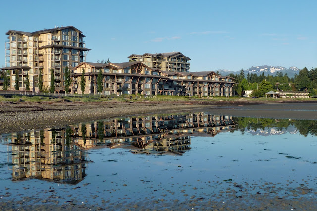Parksville's Beach Club resort reflected in the tidal pools of the main beach...