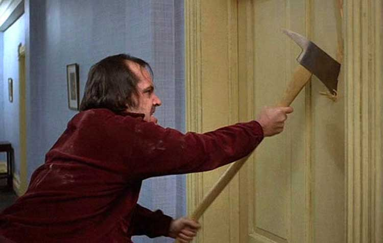 Jack smashes through the door in Stanley Kubrick's The Shining.