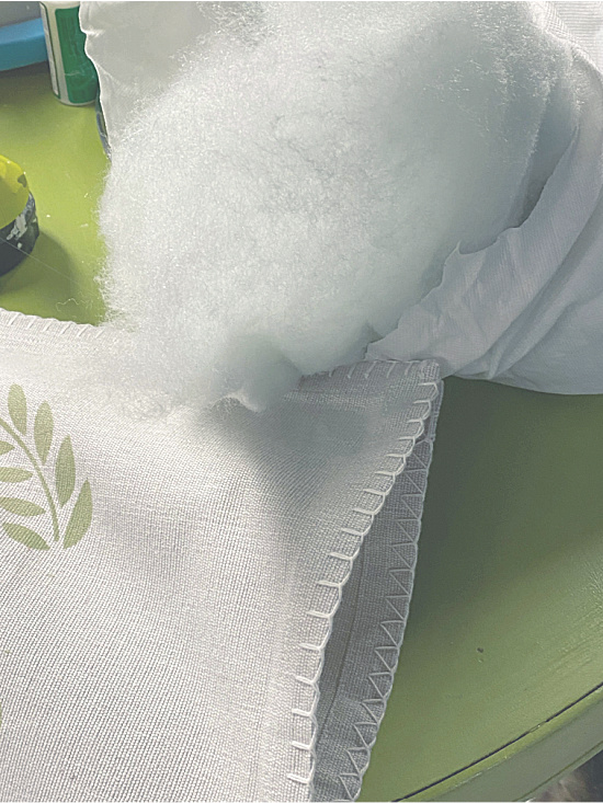 filling a pillow with Polyfil.