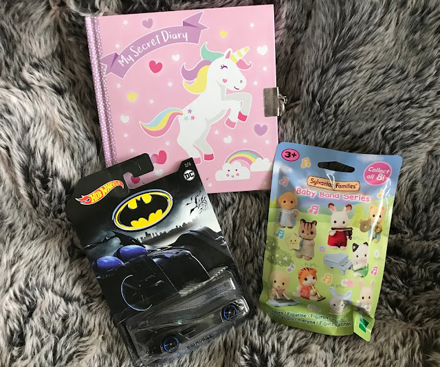 batman hotwheel car, sylvaian families blind bag and unicorn diary