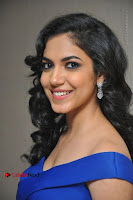 Actress Ritu Varma Pos in Blue Short Dress at Keshava Telugu Movie Audio Launch .COM 0012.jpg