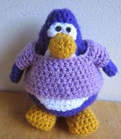http://www.craftsy.com/pattern/crocheting/toy/club-penguin-tank-top-and-shirt/90649
