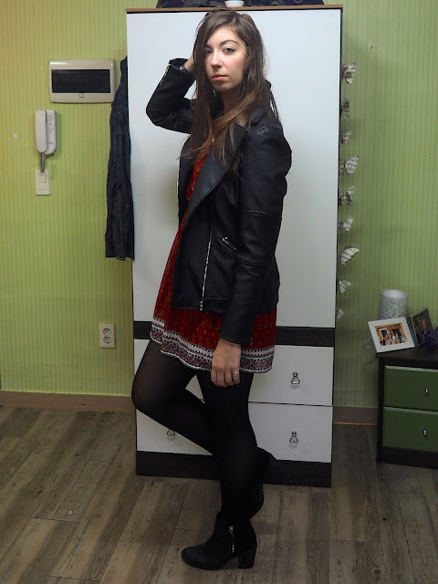 Be Bold | outfit of red patterned dress, black leather jacket, and black heeled ankle boots