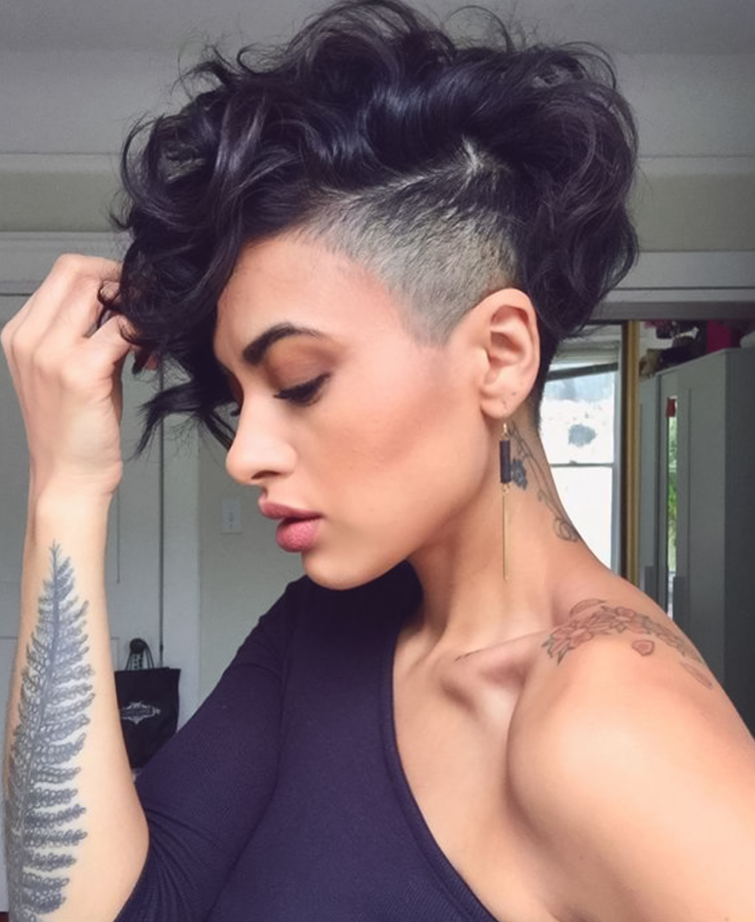 woman with buzzed side, curly hair