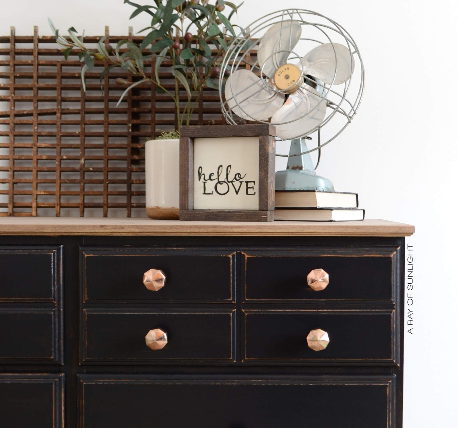 How I updated a vintage dresser by replacing it's fake wood top with real wood for a farmhouse rustic touch! Topped off with a Country Chic Paint black bottom and fancy gold knobs. By A Ray of Sunlight