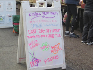 "A hand-lettered sign that reads, ""Last day of market, thank you for a great year!"""