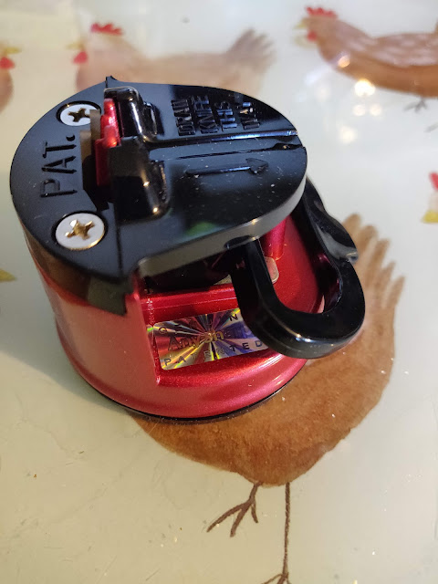red AnySharp Pro knife sharpener fixed to worktop with suction cup
