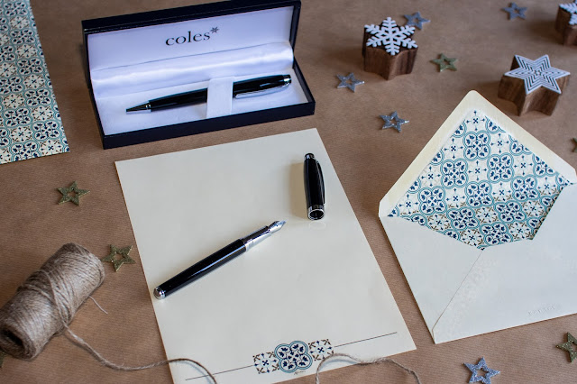 A writing set which can be engraved from Coles with ballpen and fountain pen set and writing paper with a blue tile like pattern