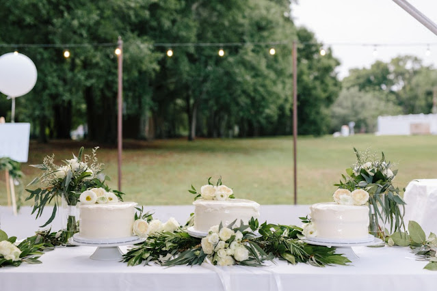 small white wedding cakes with greenery