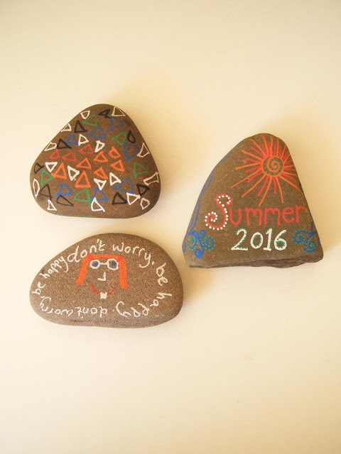collection of pebbles we decorated with posca pens