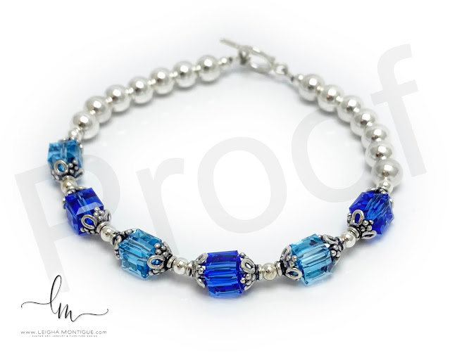 Birthstone Bracelet with March or Aquamarine and September or Sapphire birthstone crystals by Swarovski.