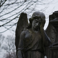 statue-girl-with-wings-holding-head