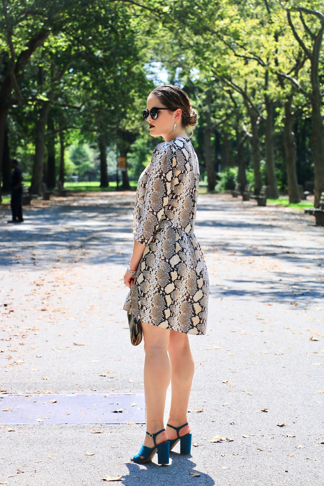 Nyc fashion blogger Kathleen Harper wearing an Anthropologie python print dress.