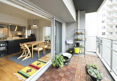Apartment modern balcony design with wooden floor and small garden on balcony ideas