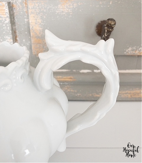 white porcelain pitcher pointy scrolly handle