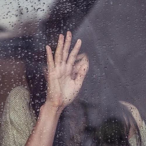 girl crying on window