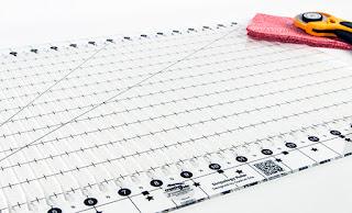 http://www.fatquartershop.com/creative-grids-non-slip-stripology-ruler