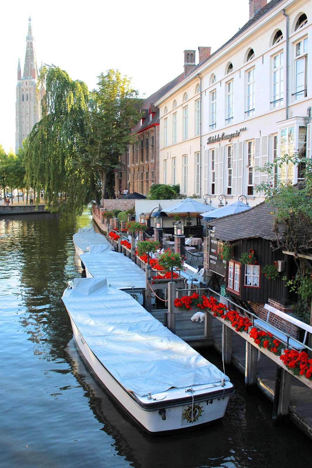 Beautiful canals and boats of Bruges in August