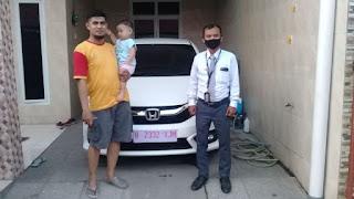 Kirim mobil Honda Brio E CVT warna white orchid pearl ke alamat: Jalan Paus, Harapan Jaya, Bekasi Utara, Kota Bekasi, Jawa Barat.