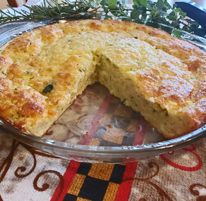 this is a zucchini quiche in a pie plate with a pie missing