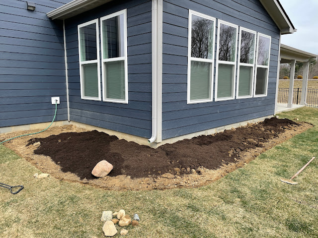 adding topsoil to new landscaping bed