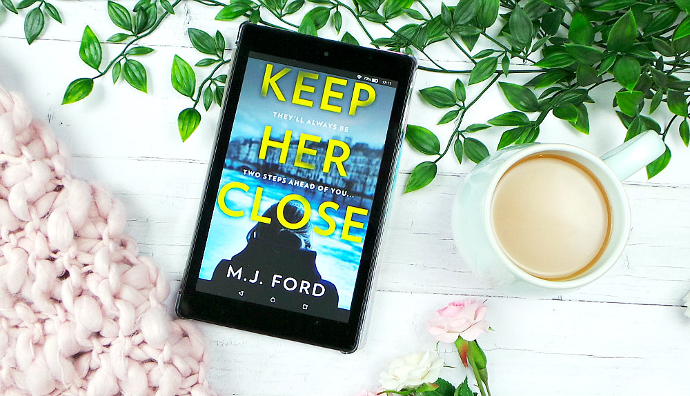 Kindle fire screen showing the cover of Keep Her Close by M.J Ford.