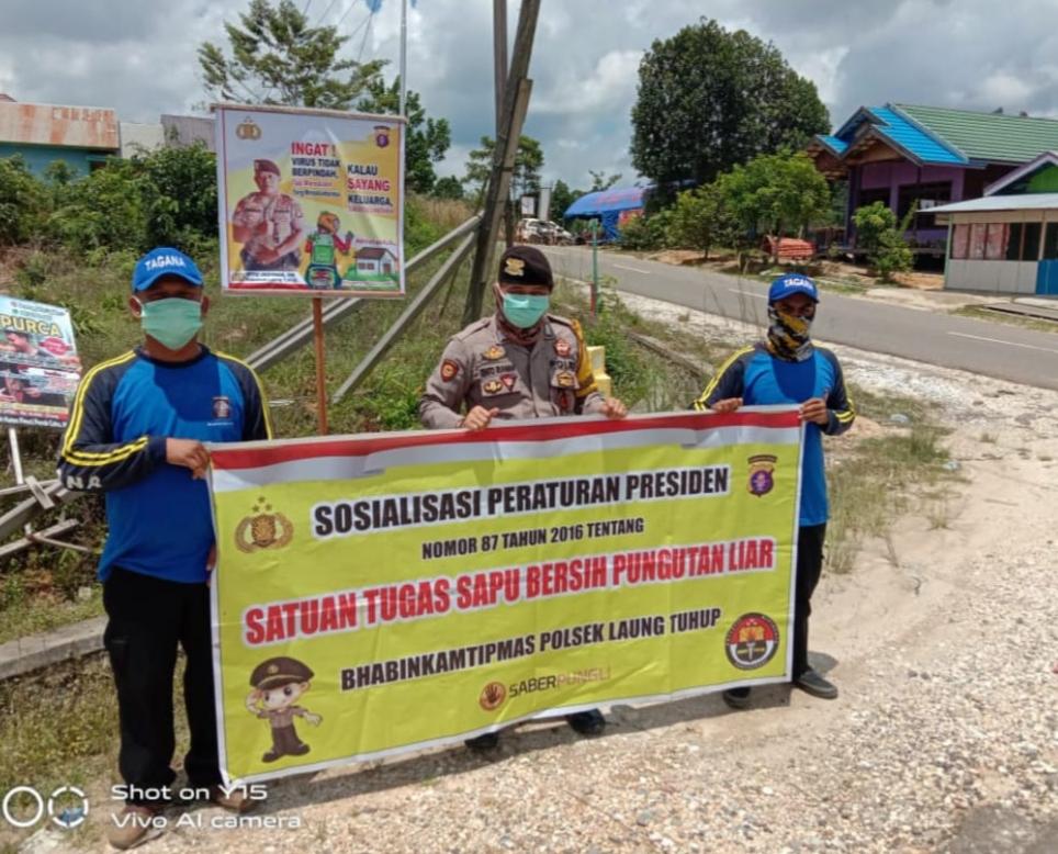 Cegah Pungli, Bripka Rinto Sosialisasikan Perpres No 87 Tahun 2016 Ke Warga Kel. Muara Laung