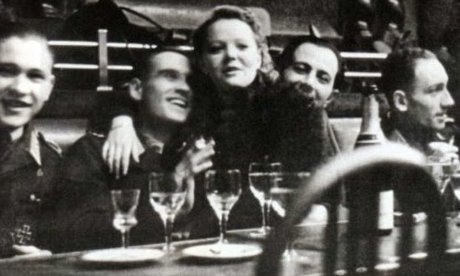 Festival atmosphere: A French woman cavorting with members of Hitler's SS in bars and cabarets. To say that all these women had no choice is a bit much.