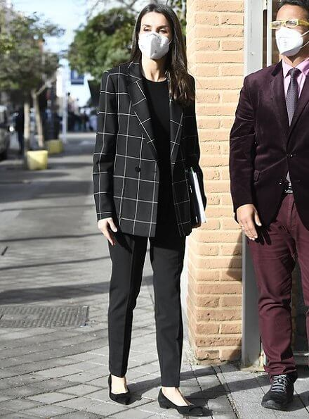 Queen Letizia wore a windowpane blazer from Hugo Boss, and black cashmere sweater from Hugo Boss