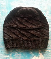 http://www.ravelry.com/patterns/library/black-melt---the-hat
