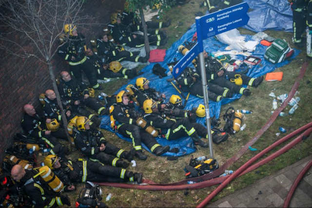Heroes! Photo of firefighters looking very tired after putting off the Grenfell towers fire