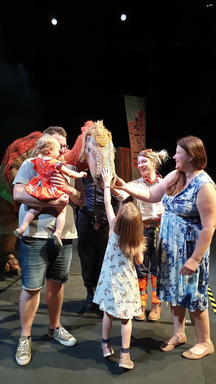 petting a dinosaur as a family