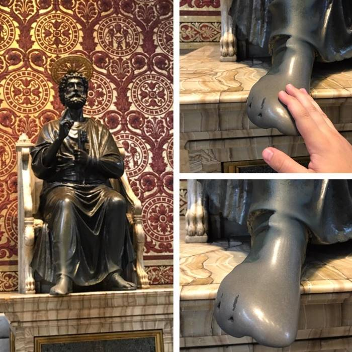 Worn down foot on centuries old bronze statue of St Peter in St Peter's Basicila in the Vatican City