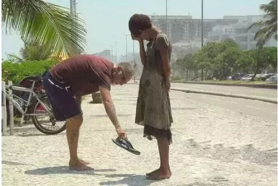 This photograph of a man giving his shoes to a homeless girl